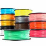 PLA is sold in many forms, here: as feed for a 3D printer.